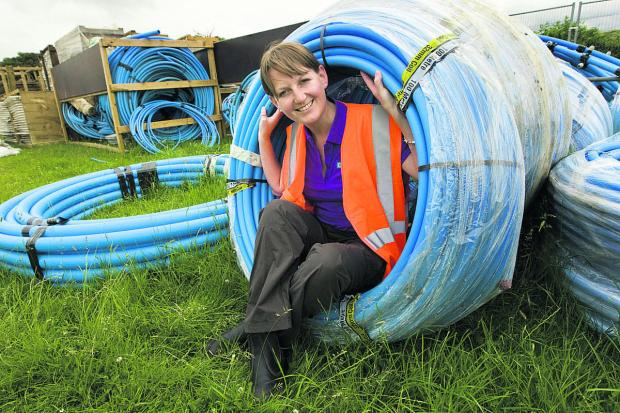 thisisoxfordshire: Head of operations Liz Haynes with some of the 10km of underground water piping to be installed