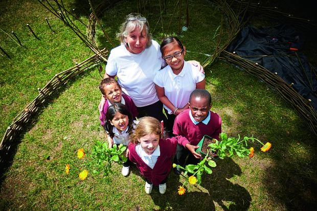 thisisoxfordshire: Clockwise from top, Blackbird Leys Academy Executive headteacher Jill Hudson, with pupils Joyce Conception, 10, Loqman Mattery, eight, Maddy Lee, eight, Aleesha Abassi, seven, and Jake Fryer, five   Pictures: OX6799 Cliff Hide