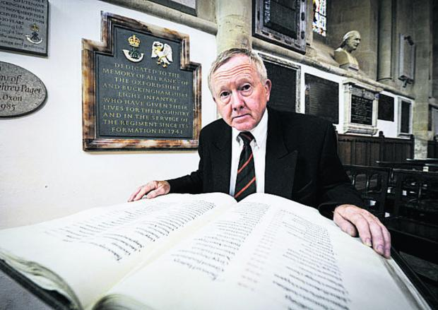thisisoxfordshire: Terry Roper, Chairman of the Oxford branch of the Royal Green Jackets Association with the book of names of soldiers from the Ox and Bucks regiments who have died in both world wars.  Picture: OX68036 Mark Hemsworth