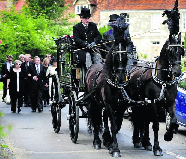 thisisoxfordshire: Carol Tasker is taken from Mill Lane, Marston, in a horse-drawn carriage, followed by her family