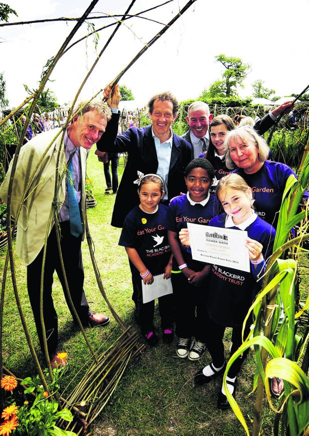 thisisoxfordshire: Back, from left, Tim Miles, head gardener at Cotswold Wildlife Park, Monty Don, Jim Buttress, Bethany Mayhew, 10, and Blackbird Leys Academy executive head Jill Hudson. Front, Lorena Babie, seven, Alexander Clovis, 11, and Anita Begu, 10 Picture: OX68057