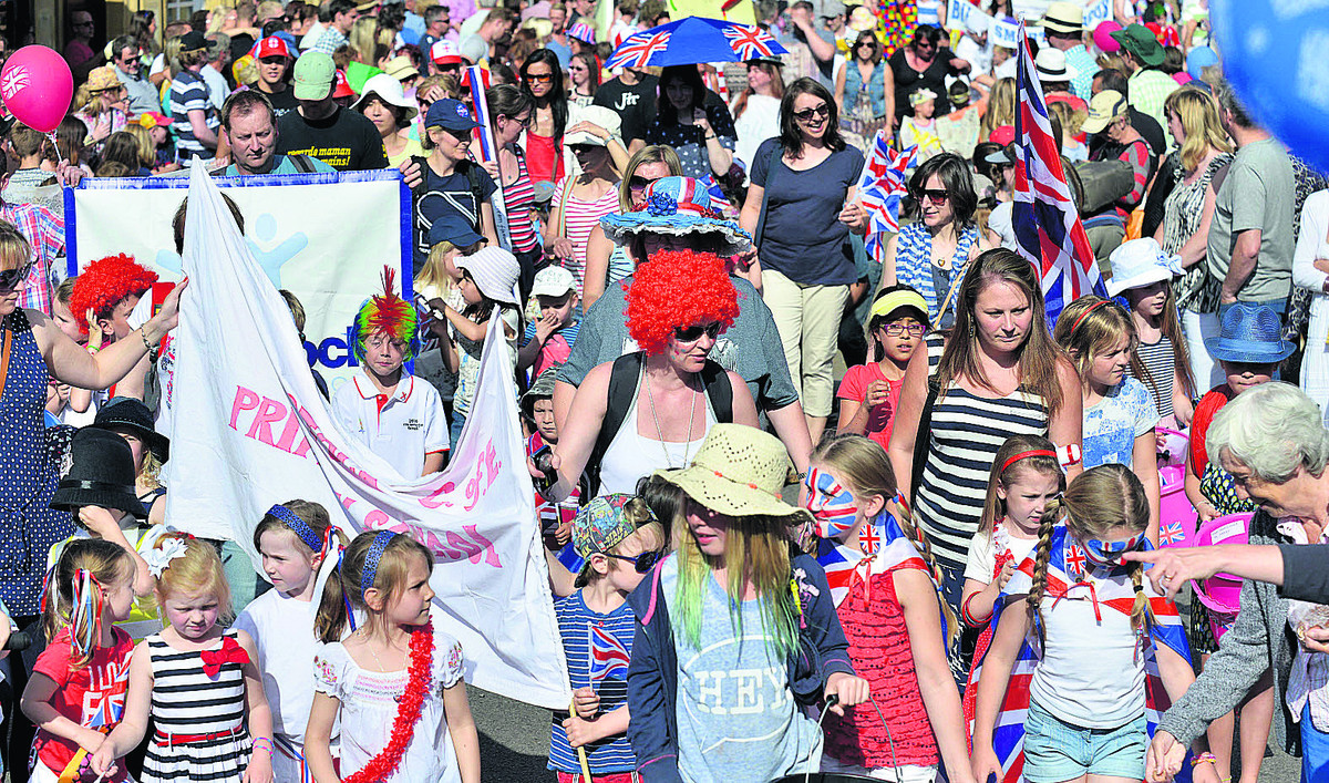 Pupils and staff from Woodstock Primary School in the front taking part in the Woodstock Carnival parade