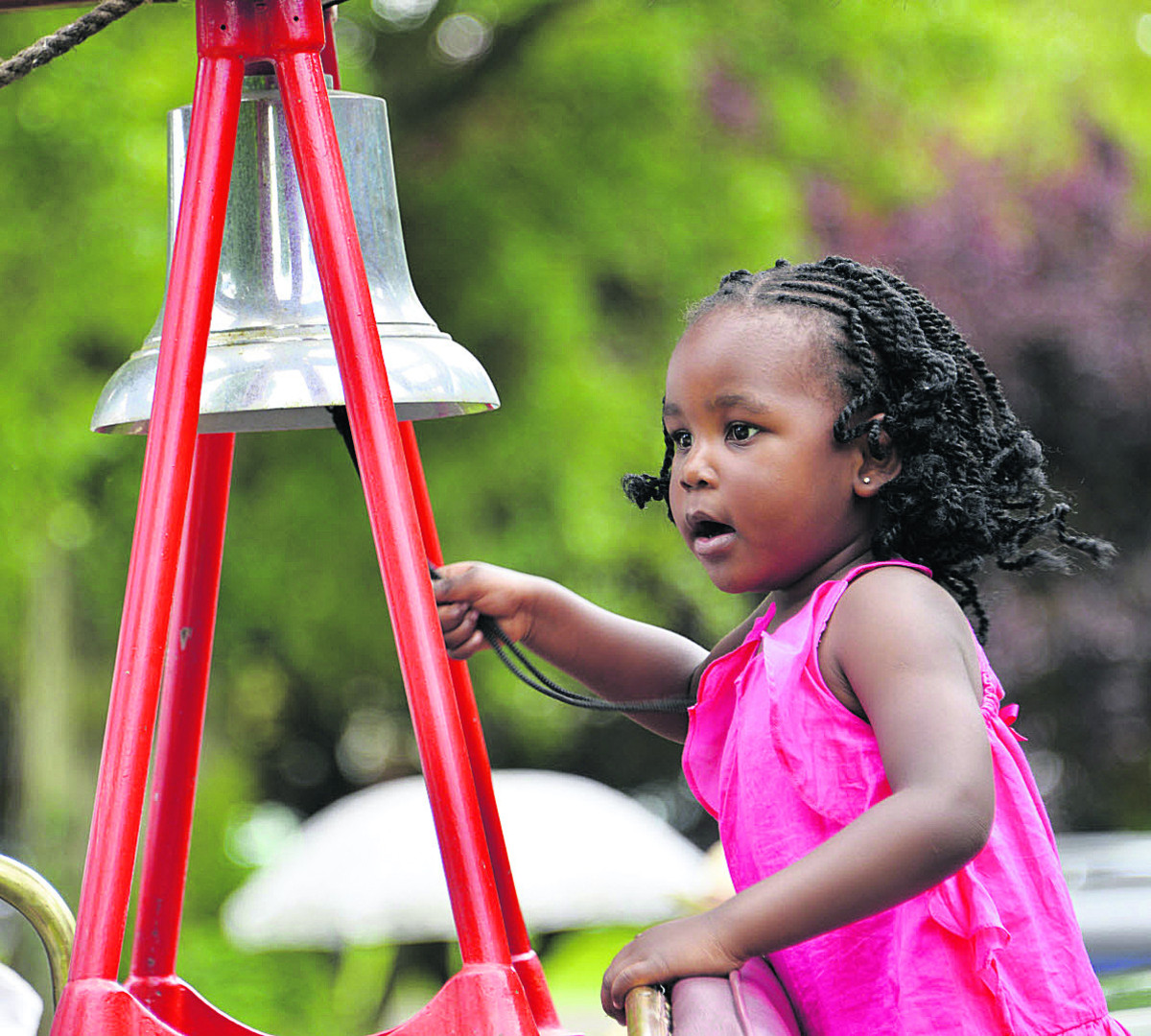 Serah Puleiy, three, rings the bell on a fire engine.