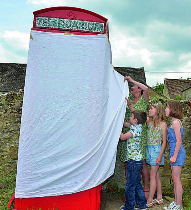 thisisoxfordshire: Unveiling the new ArtBox in Beckley, are from left artist Becky Paton with pupils from Beckley Primary School, Becky's son Felix Paton, seven, Lucy Walton, nine, and Leila Branfoot, 10