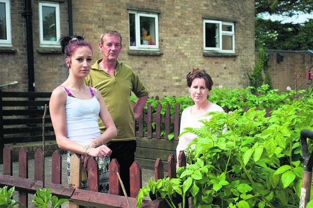 thisisoxfordshire: From left, residents Laura Berry, Andrew Samuel and Deborah Cox by the garden                                  	        Picture: OX68142 Andrew Walmsley