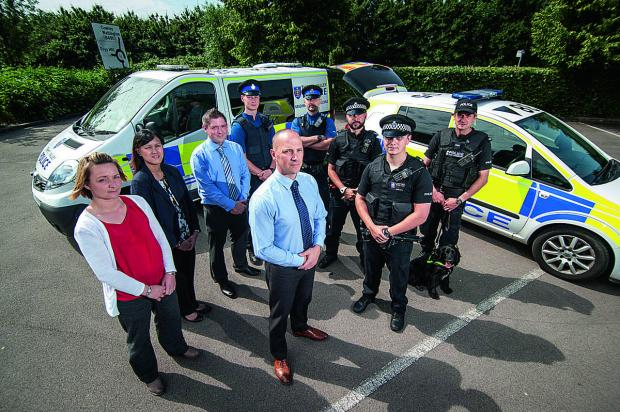 thisisoxfordshire: Front centre, Det Sgt Bill Sykes of St Aldate's CID with some of the officers involved in the operation