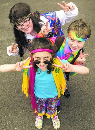 Liam Gamble, 10, back left, with Hayley Evans, nine, and Aidan Long, nine