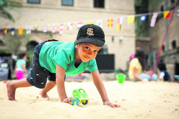 Cayden Nembhard plays with a tractor in the sand  Pictures: OX67457 Andrew Walmsley