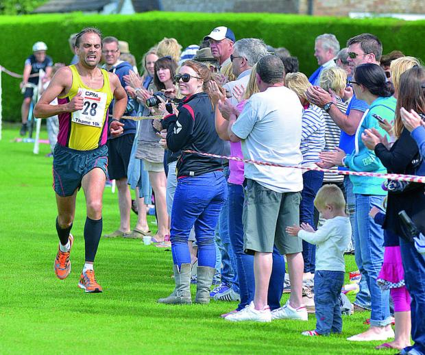 thisisoxfordshire: Cheered on by the crowds as he comes in second at the Thame 10k yesterday is Paul Fernandez running, for Abingdon AFC