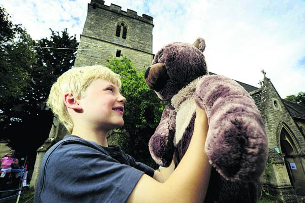 Oliver Roberts, seven, with his teddy Brian at St Peter's Church in Wolvercote