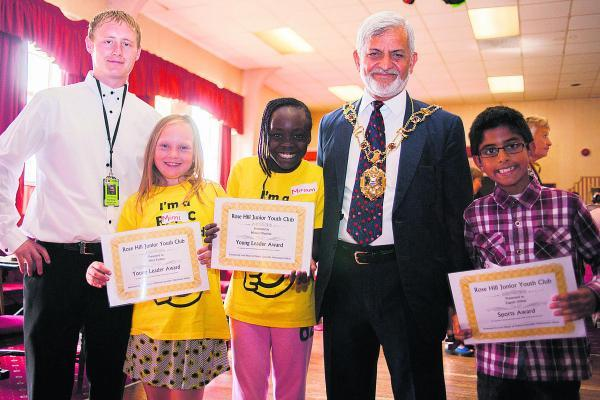 thisisoxfordshire: Pictured with lead playworker Jamie Bourton, left, and Lord Mayor of Oxford Mohammed Abbasi are, from left, nine-year-olds Mimi Partlett, Miriam Olayinka and Zagum Abbas after receiving their Young Leader Award certificates