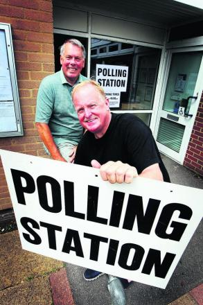 Parish council chairman Charlie Haynes, front, and Peter Cox outside the Mortimer Hall polling station in Old Marston
