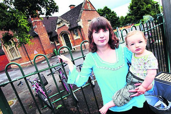thisisoxfordshire: Leanne McClements, pictured with 11-month-old son Rowan, is concerned that noise and vibrations from trains will affect children at Wolvercote Primary School