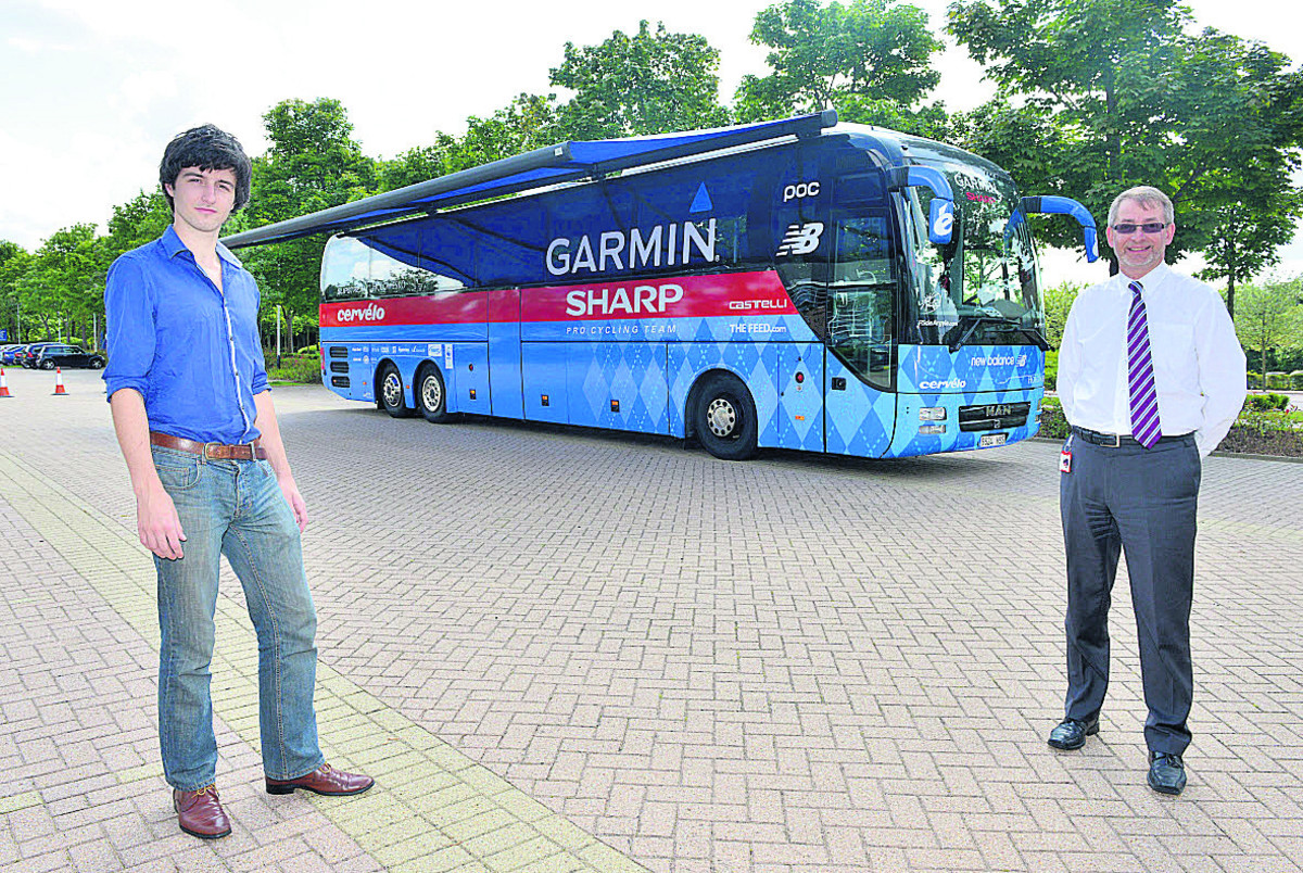 Josh Robson-Hemmings, left, and Ian Thompson, managing director of Sharp Laboratories at Oxford Science Park, with the Garmin-Sharp cycle team's Tour De France coach