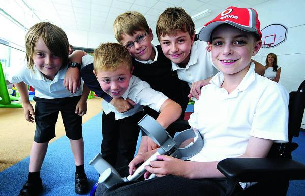 thisisoxfordshire: Finlay White, nine, far right, who has bone cancer, returns to Oxford Children's Hospital, with friends from his school, Ducklington Primary School, from left, Henry Skelson, Jack Peachey, Ben Miles and Henry Partlett, all aged nine