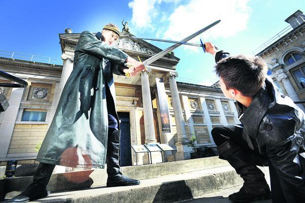 thisisoxfordshire: Alex Cowan, left, as King Arthur fights with Lancelot, played by Dan Blick on the steps of the Ashmolean