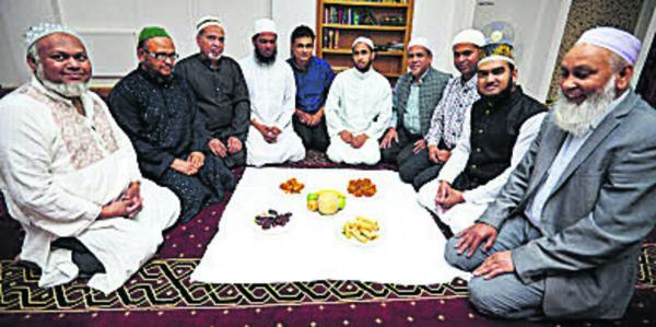 Members of the committee at Bath Street Mosque, including secretary Kamruz Zaman, second from right, and chairman Moznu Miah, fourth from right, prepare for an Iftar Party. Picture: OX68475 Cliff Hide