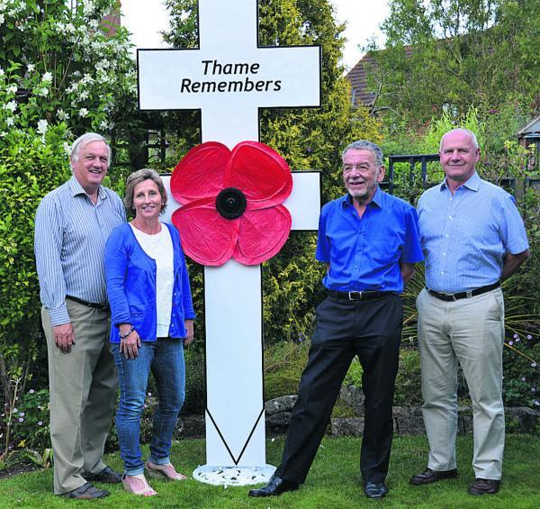 thisisoxfordshire: The steering group for Thame Remembers, from left, David Bretherton, Patsy Baker, Mike Dyer and Ian Jones with one of the crosses to honour the town's Fallen