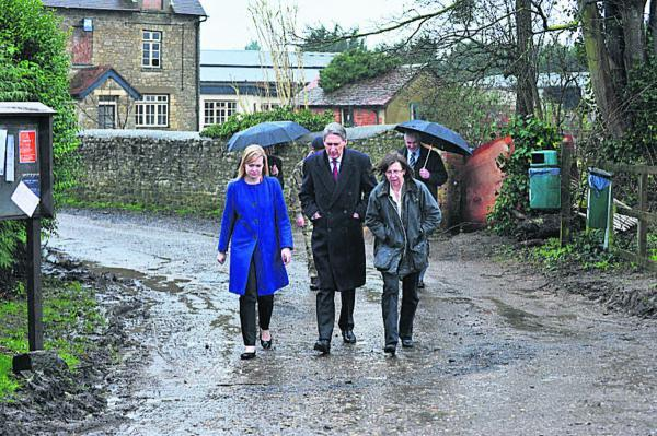 thisisoxfordshire: South Hinskey Parish Council chairman Maggie Rawcliffe, right, with Defence Secretary Philip Hammond and MP Nicola Blackwood on a visit to view flood defences in February