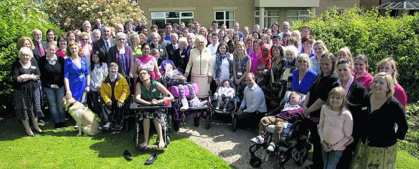 thisisoxfordshire: Tom Hill, inset, with staff and patients of Helen & Douglas House during the visit of the Duchess of Cornwall