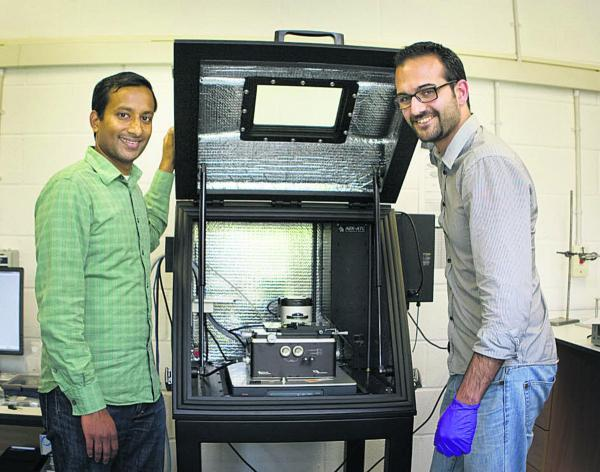 thisisoxfordshire: Prof Harish Bhaskaran, left, and Dr Peiman Hosseini with their equipment. Picture: OX68565 Antony Moore