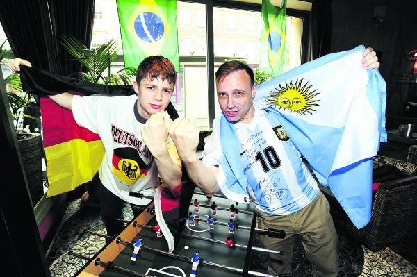 Germany fan Chris Jacobi and Argentina supporter Esteban Cichello Hübner get ready for tomorrow's World Cup final Picture: OX68587 David Fleming