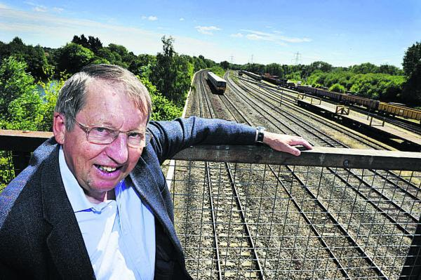 thisisoxfordshire: Cllr Bob Johnston stands above the rail track at South Hinksey that needs to be raised by a metre to prevent flooding