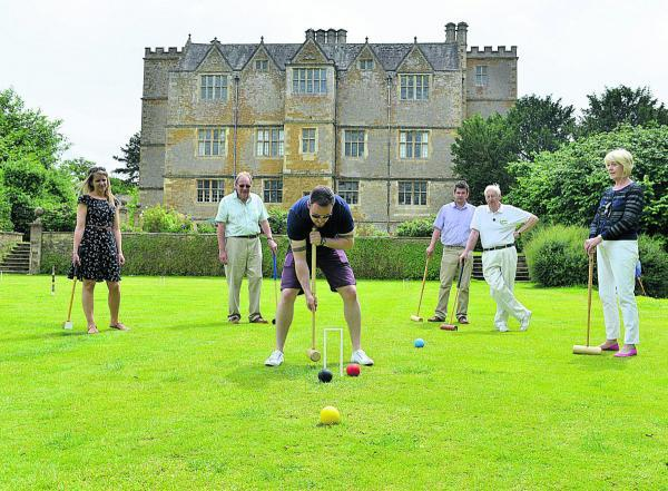 thisisoxfordshire: Andy Jones plays croquet at Chastleton House watched by, from left, Ruth Peters, David Taylor, Ben Jaques, Bob Hann and Pamela Taylor