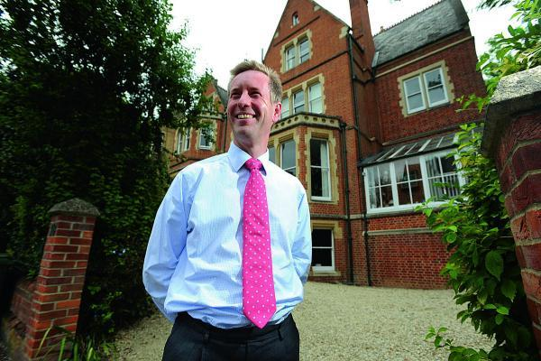 Mark Charter, head of the Carter Jonas estate agents' Oxford office, at the flat in Norham Gardens, Oxford, which is up for sale for £1.4