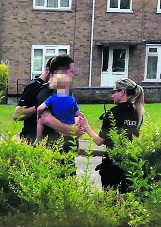 thisisoxfordshire: Police officers take the child yesterday morning