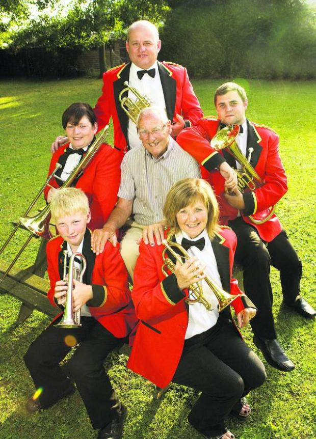thisisoxfordshire: Members of Jubilee Brass Band. Back: Nigel Menbury. Middle: Linda Sadler, Ken Menbury and Matthew Toms. Front: William Menbury and Sandra Toms                            Picture: OX68711 Antony Moore