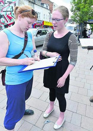 Eleanor Hathaway signs the petition for Sophie Williams