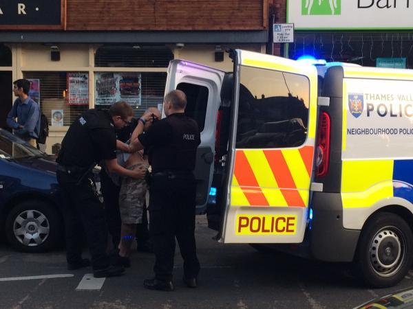 thisisoxfordshire: A man is put into the back of a police van on Cowley Road