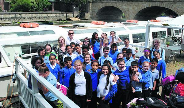 thisisoxfordshire: New Marston Primary School pupils in their floating classroom during an educational trip on the Thames