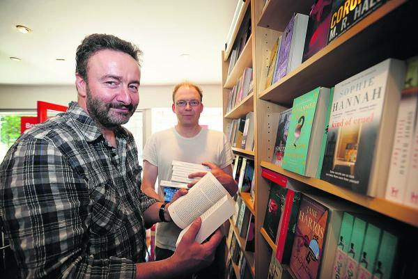 Owner of The Last Bookshop, Jake Pumphrey, left, and manager Patrick Curran
