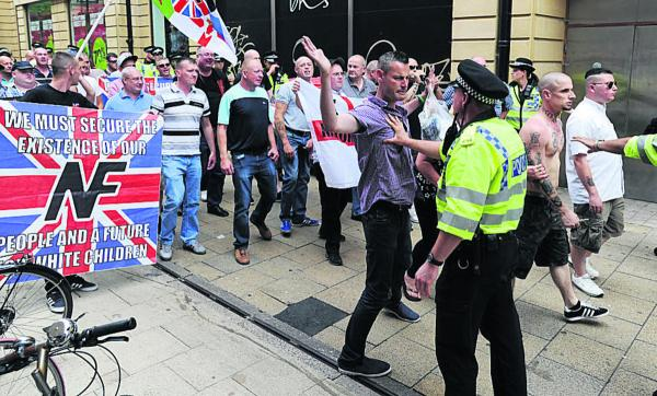 National Front members square up to the police