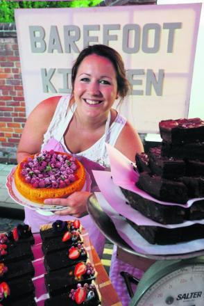 Emily Jones at her Barefoot Kitchen cake stall at North Parade market.  Picture: OX68830 Jon Lewis
