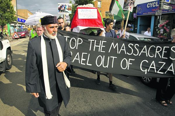 Dr Hojjat Ramzy, left, at the demonstration.  Picture: OX68998 Antony Moore