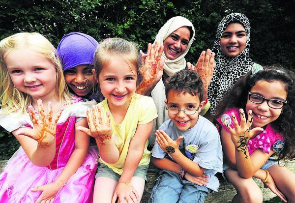Clockwise from left, Maya Kozlovska, four, Hira Hussain 11, Alicja Szwajca, five, Nighat Shan, Tomas Ruge, five, Hafsah Hussain 13, and Matilde Ruge, nine, show off their henna tattoos