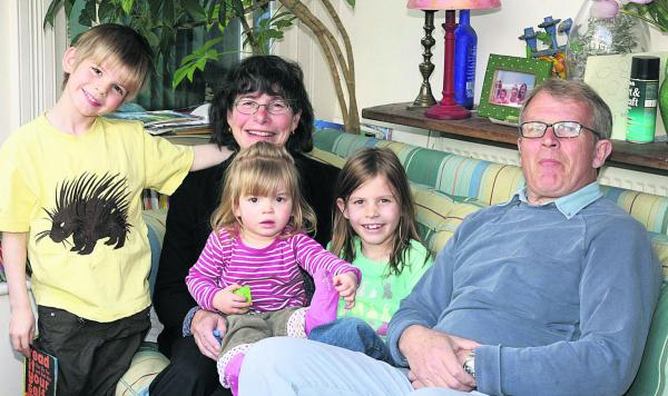 Dr Ann McPherson pictured on her retirement in 2008 with her husband Klim and grandchildren Sonny, then aged six, Alma, 20 months, and Josie, eight
