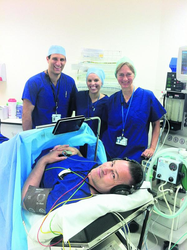 From left, Dr Vassilis Athanassoglou, Dr Anna Wallis and consultant Dr Svetlana Galitzine, with Mik Ashfield, senior operating department practitioner demonstrating the equipment