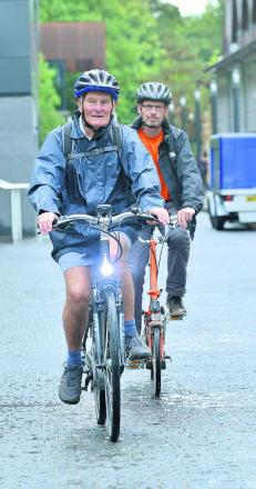 Brian Hook, front, gives cycling a go with Oxford Brookes University research assistant Ben Spencer