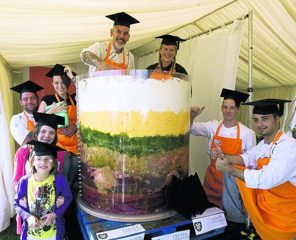 Exeter College staff pictured at the 2010 festival with a giant trifle they made with the help of local children