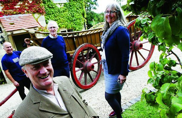 thisisoxfordshire: Front, David Willcock, who is playing villager John Sharp who used to drive the wagon, with village archivist Ian Costar and Christine Jeuckens, from Oxfordshire County Council  				                   Picture: OX69212 Ed Nix