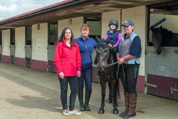 From left, Lydia Coppola, Wendlebury Gate Stables owner Hazel Offord, Emilia Tranter and instructor Sue Mckecknie with Colin the Pony