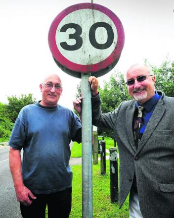 Parish council chairman Colin Charlett, left, and Said Business School estates project officer Martin Boyt are pleased the 30mph limit is being extended Picture: OX69571 Jon Lewis