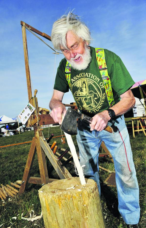 Ray Borrett whittles wood at last year's fair