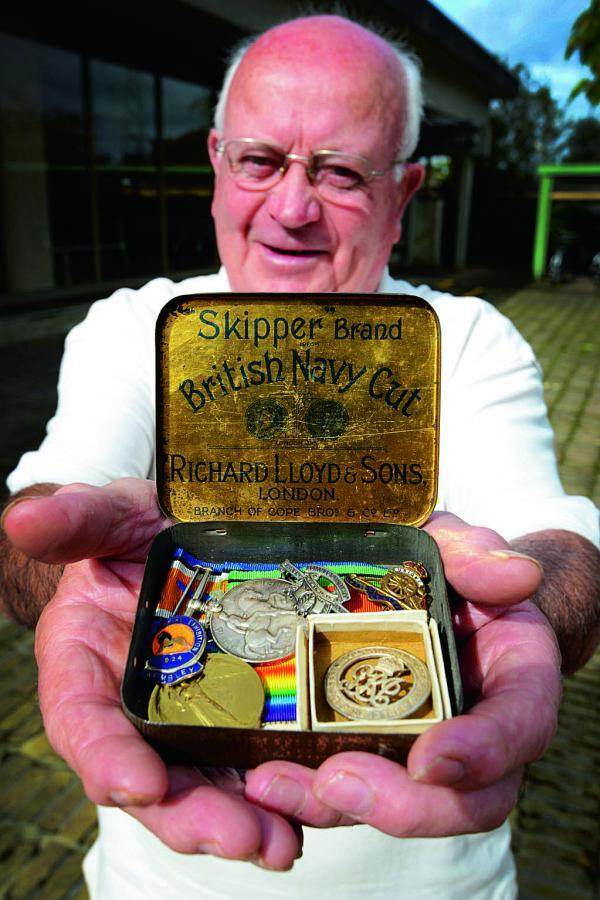 Michael Quirke with the tin of medals