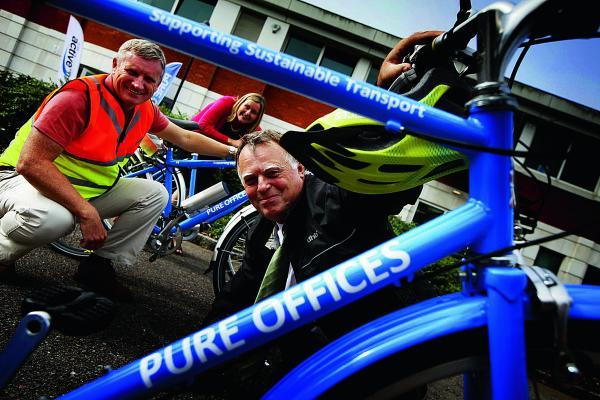 thisisoxfordshire: Oxford East MP Andrew Smith at the sustainable transport roadshow in Oxford Business Park, encouraging people to cycle to work. He is pictured with bike builder Stephen Preston and MD of Pure Offices Katie Whell. Picture: OX69705 Ed Nix
