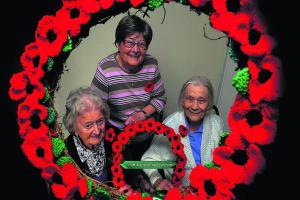 Care home residents knit poppy wreaths as a tribute